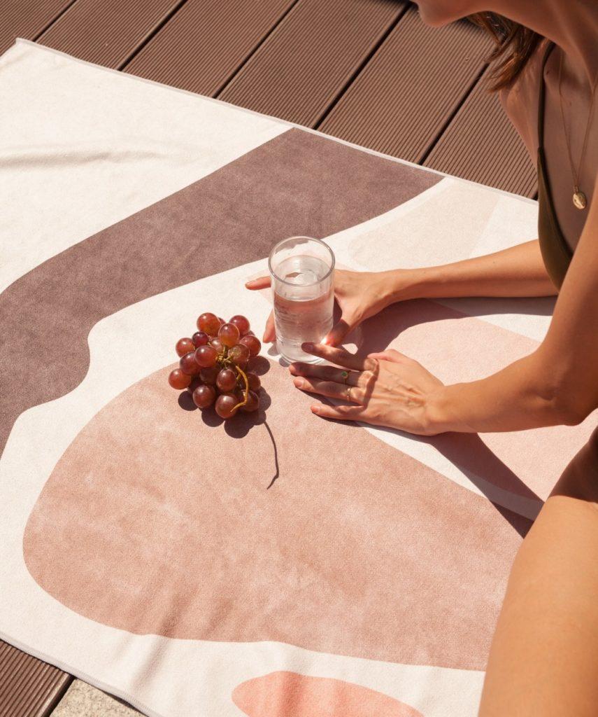sora beach towel on the floor